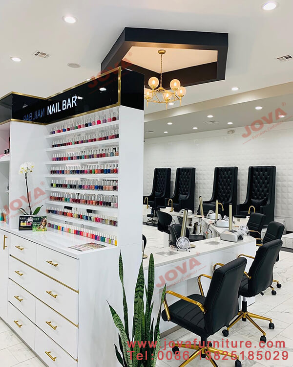 Nail wall displays and manicure tables